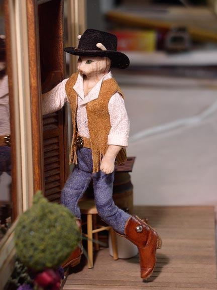 CDHM Artisan Deborah Mackie of Whitehorse Studio hand sculpted this cowboy doll in dollhouse miniature scale, 1:12