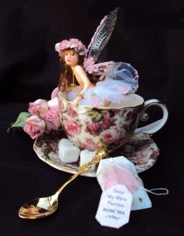 CDHM Gallery of Judy Raley of Once We Were Faeries creates original one of a kind art dolls, including fairies and fairy children, dressed, wigged and ready for display in varying sizes from dollhouse mini size to 10 inches