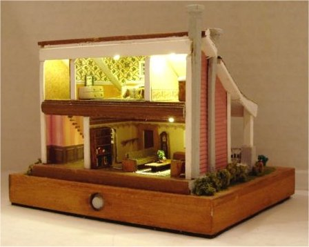 Interior and lite Crafters cottage in 144 scale by CDHM Artisan Lauretta Carroll of Midnight Magic Miniatures