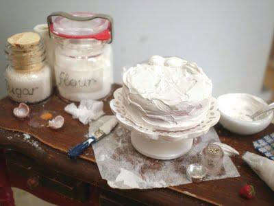 OOAK preparation table in 1:12 scale, frosting a cake for the dollhouse miniature kitchen by CDHM Artisan Veselina Koleva of Vesper Miniatures