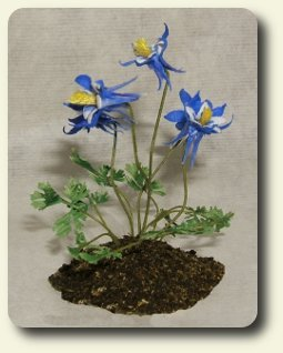 by CDHM Gallery of Abby Benner of Mini-Quest creating 1:12 scale dollhouse miniature hand sculpted and hand cut flowers, potted plants, vegetables, vegetable gardens for dollhouse settings