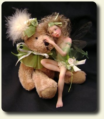 CDHM artisan Judy A. Raley created this handmade sculpted and dressed fairy child with teddy bear in 1/12 scale dollhouse miniatures