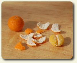 CDHM artisan Hanna Lindroth doing business as Mini Chef shows you a how-to on making peeled oranges in dollhouse 1:12 scale