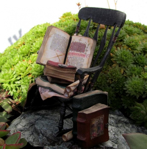 CDHM Artisan Karin Caspar of KC-Design creating 1:2 dollhouses, dollhouse furniture, paperclay, books, spooky bookcases, witch cabinets, spooky dollhouse, readable books for the dollhouse miniature collector