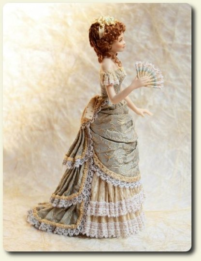 CDHM artisan Elisa Fenoglio, side view of miniature porcelain doll in 1800's dress