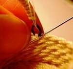 sewing the handle to the basket
