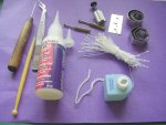 Tools and supplies used to sculpt a dolls miniature wedding cake