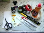 Tools and supplies needed to make a dolls house desk set with ink blotter and feather pen